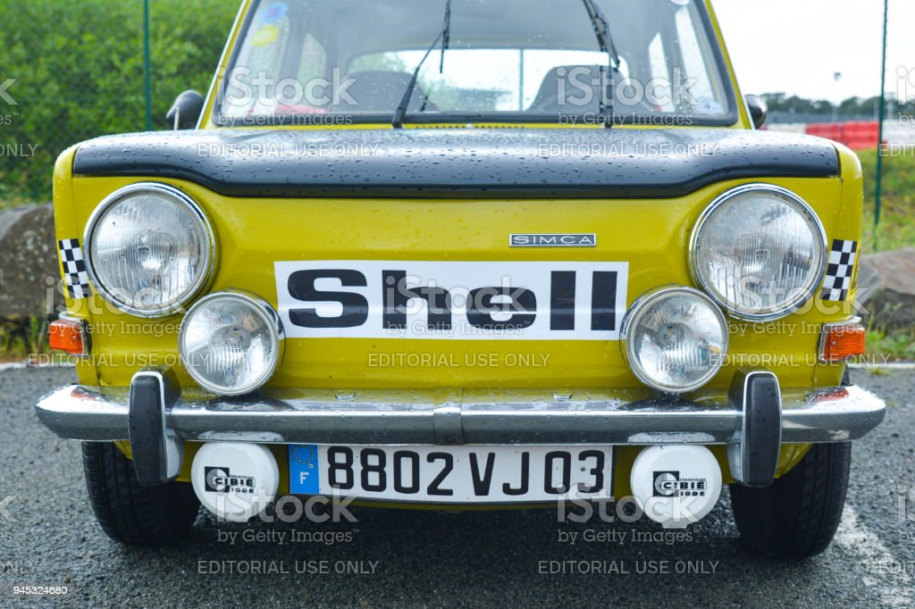 Vintage french race touring yellow car Simca logo Shell stock photo