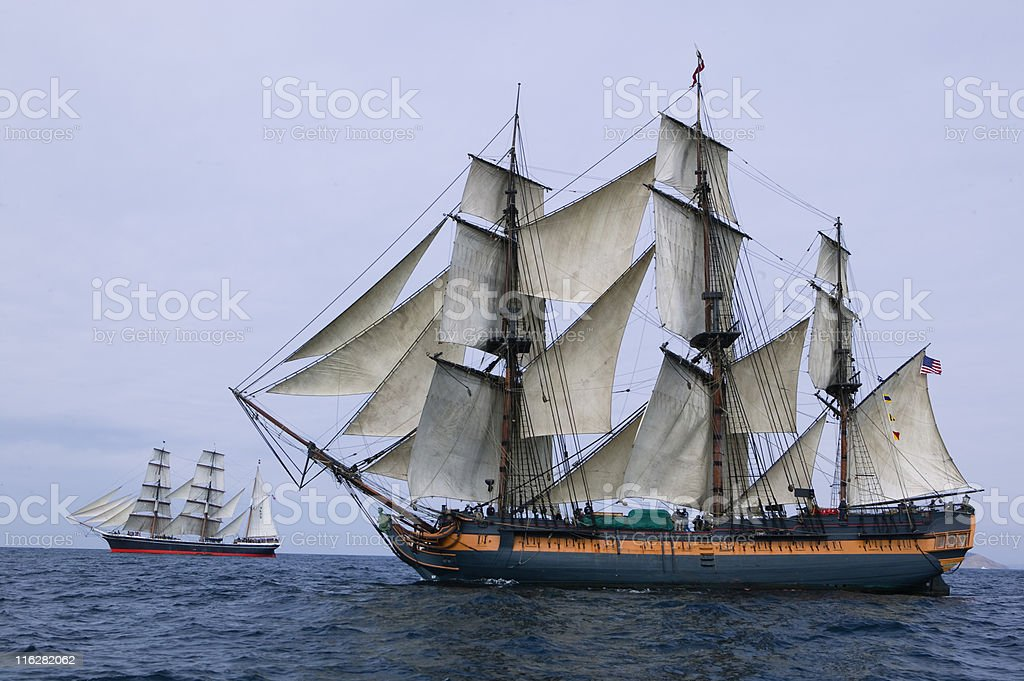 Vintage Frigate sailing at sea under full sail stock photo