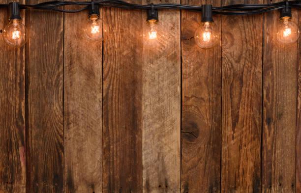 vintage slinger string verlichting - snoerverlichting stockfoto's en -beelden
