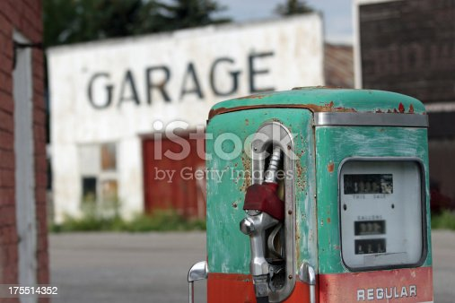 Vintage gas pump at an abandoned station.