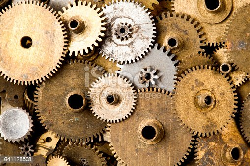 istock Vintage gears macro view. Aged mechanical clock wheels background. Shallow depth of field, soft focus 641128508
