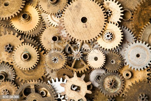 istock Vintage gears macro view. Aged mechanical clock wheels background. Shallow 626194366