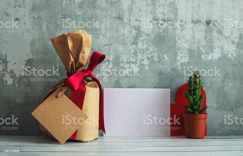 Vintage gift box package, cactus and empty tag on old wooden...