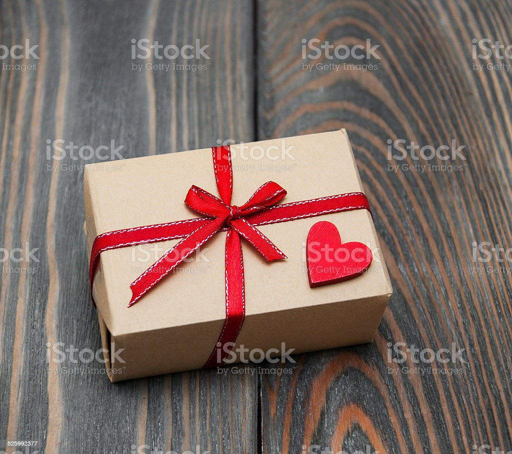 vintage gift box package on old wooden background