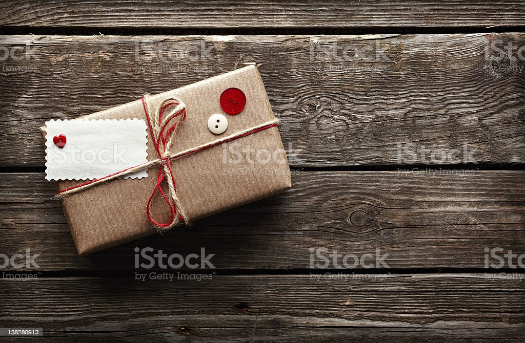 Vintage gift box with tag on wooden plates stock photo