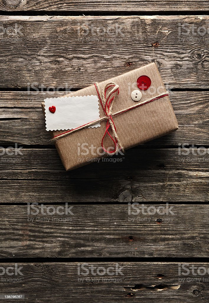 Vintage gift box with tag on wooden plates. royalty-free stock photo