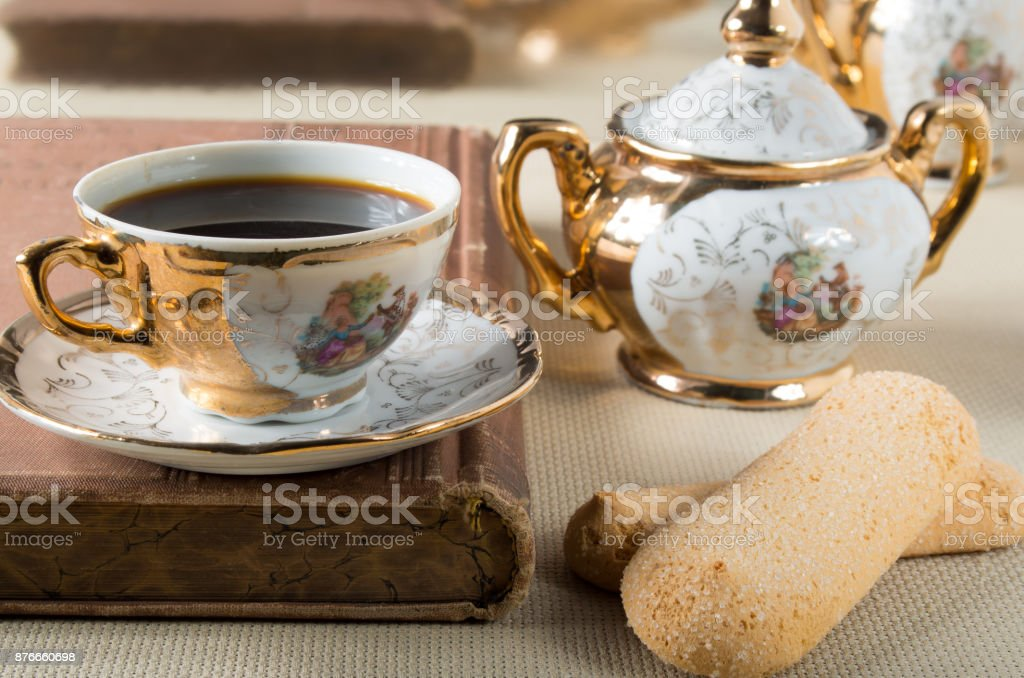Vintage gilded porcelain tableware stock photo