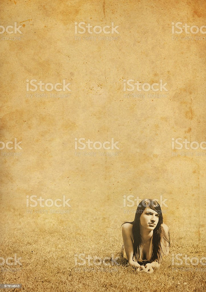 vintage girl in the grass royalty-free stock photo