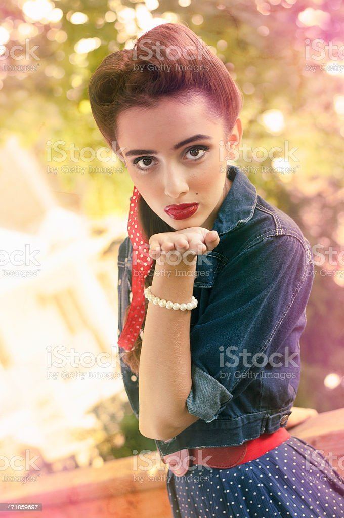 Vintage girl sending a kiss royalty-free stock photo