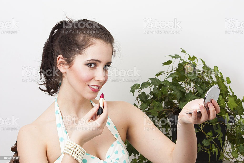 Vintage girl with lipstick royalty-free stock photo