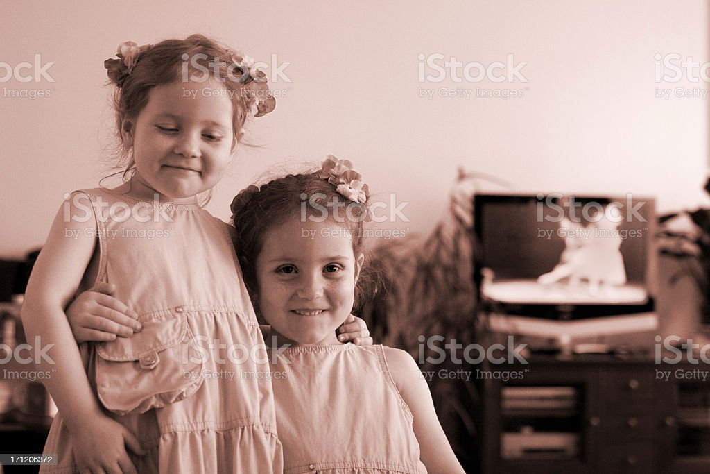 """Vintage girls as best friends """"Two girls, aged 3 and 5, holding each other."""" Affectionate Stock Photo"""