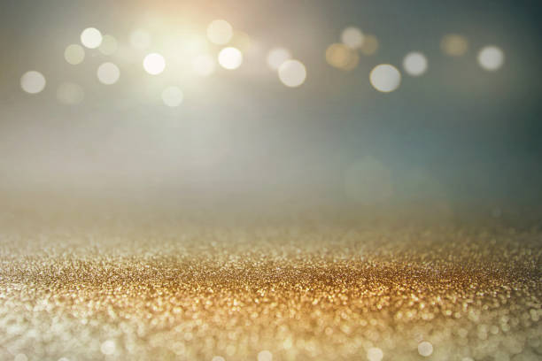 vintage glitter gold, dark blue and black lights bokeh background. - holidays and celebrations stock photos and pictures