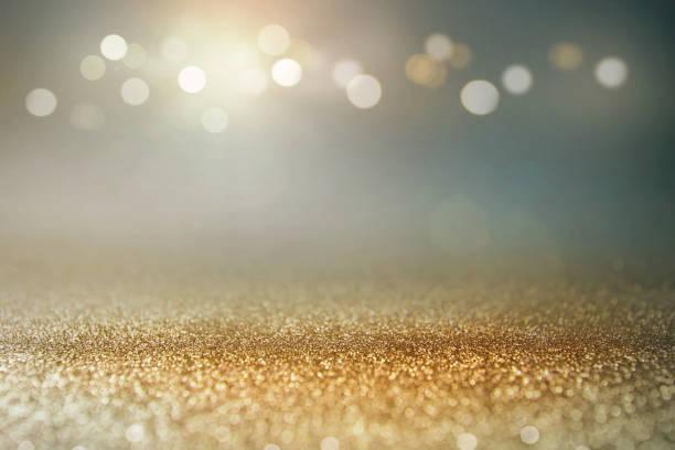 Vintage glitter gold, dunkelblau und schwarz leuchten bokeh Hintergrund. – Foto