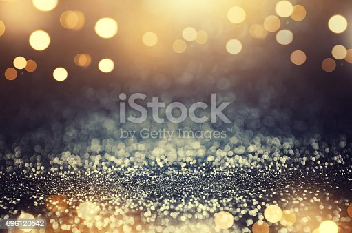 istock Vintage glitter gold, dark blue and black lights bokeh background. 696120542