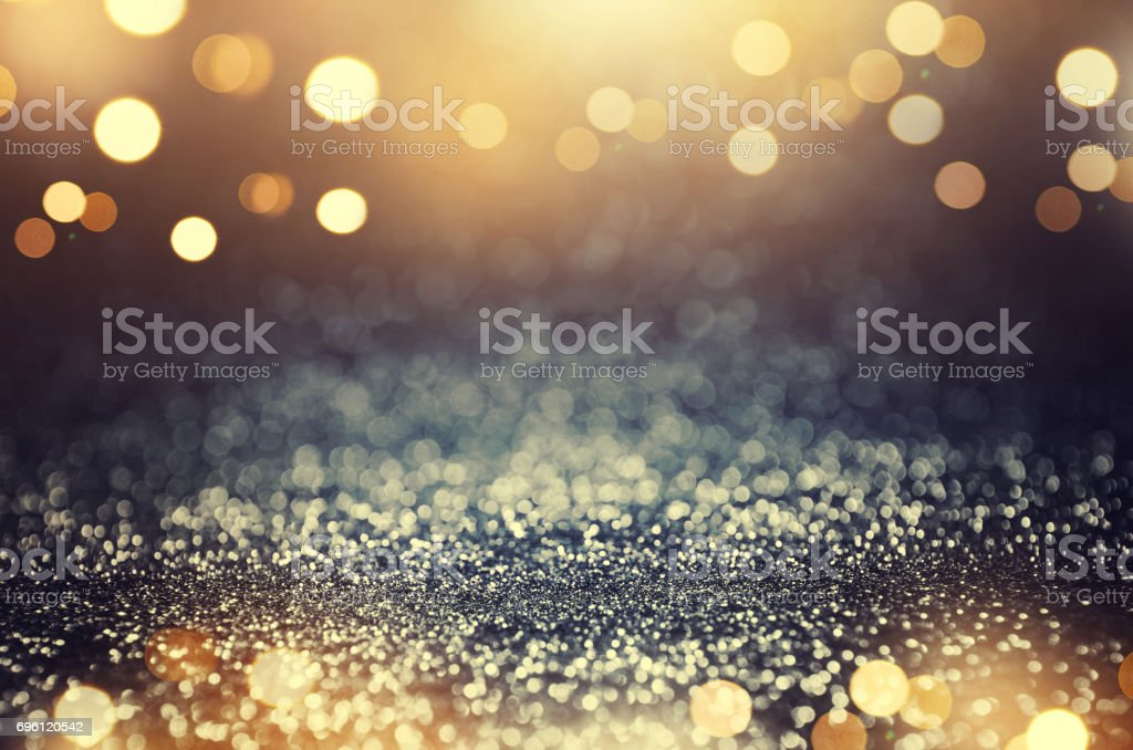 Vintage glitter gold, dark blue and black lights bokeh background. stock photo
