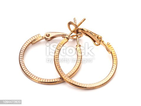 Old gold colour hoop earrings, pair, on white background.
