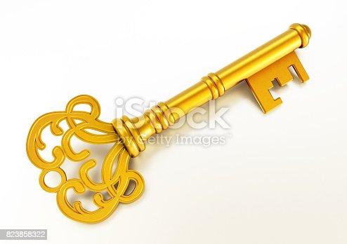 istock Vintage golden key isolated on white 823858322