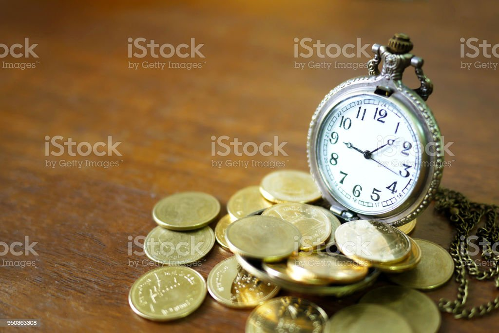 vintage golden pocket watch with stack  on wood table background. stock photo
