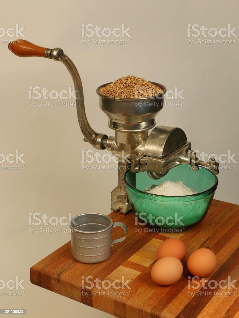 Vintage Grain Mill in Baking Scene stock photo