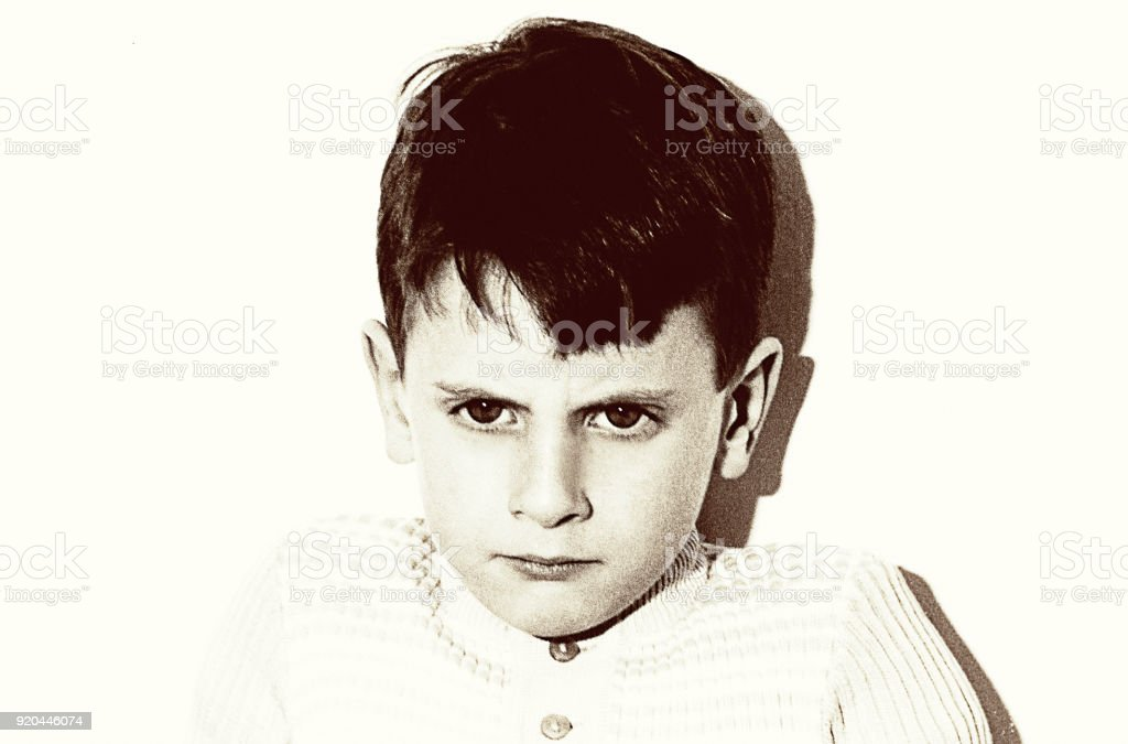 Vintage grainy black and white angry boy portrait stock photo
