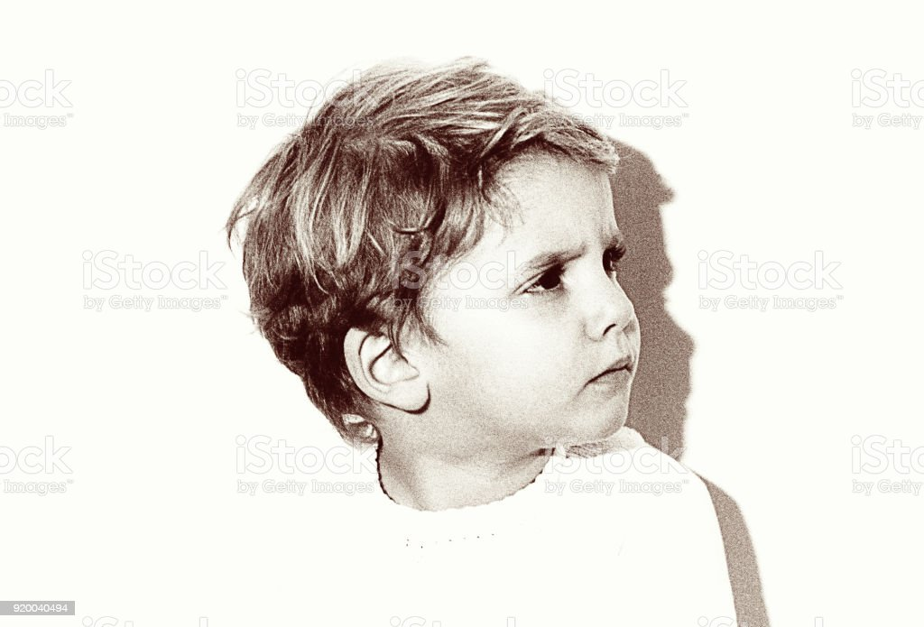 Vintage grainy black and white kid looking angry stock photo