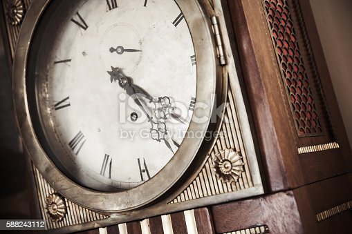 istock Vintage grandfather clock 588243112