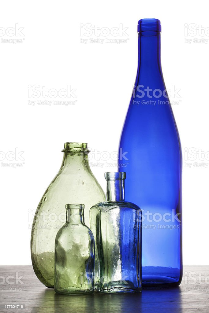 Vintage green and blue bottles on white stock photo