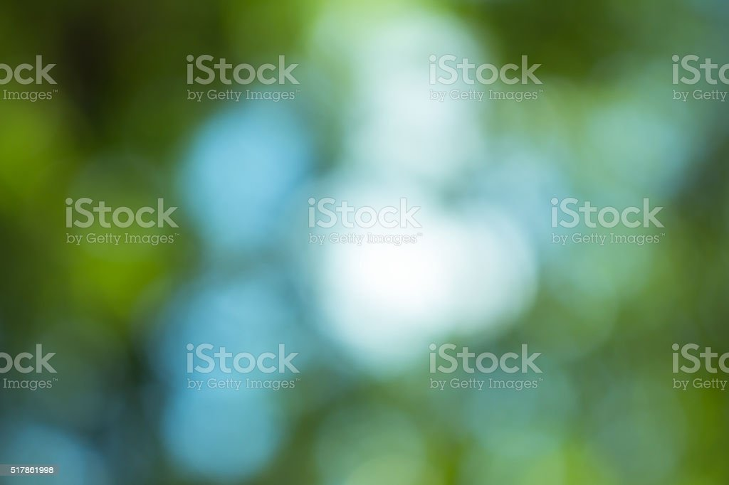 Vintage green blurred bokeh. Defocused background. stock photo