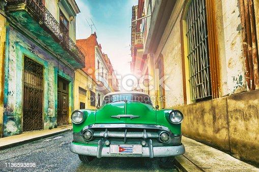 Vintage oldtimer car driving through Old Havana Cuba