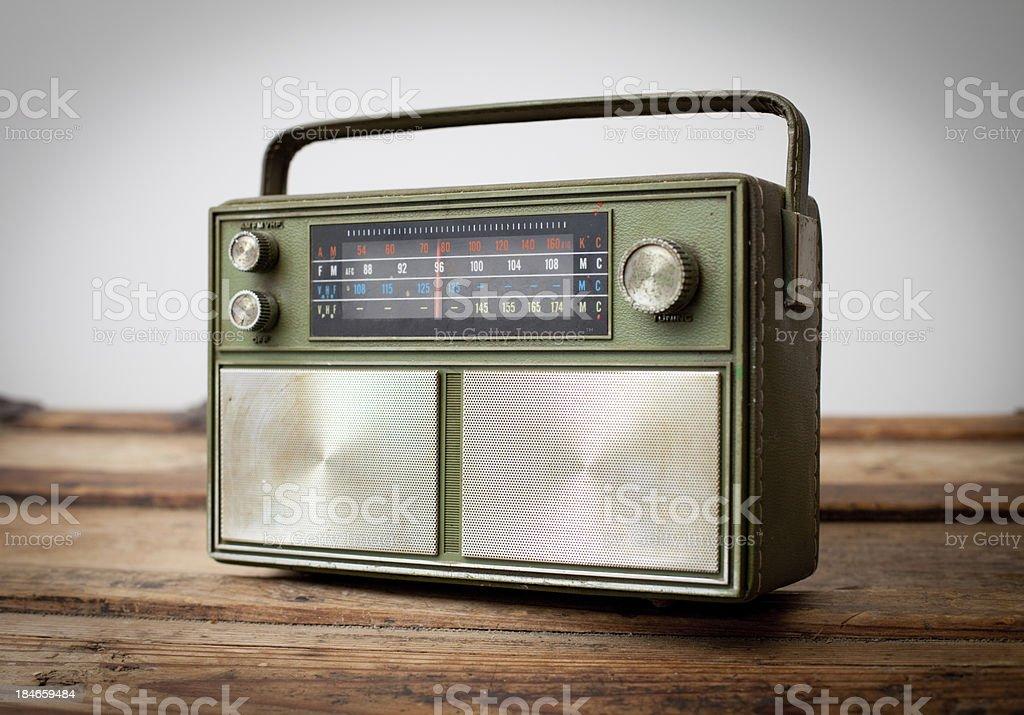 Vintage Green Portable Radio Sitting on Wood Table royalty-free stock photo