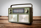 istock Vintage Green Portable Radio Sitting on Wood Table 184659484