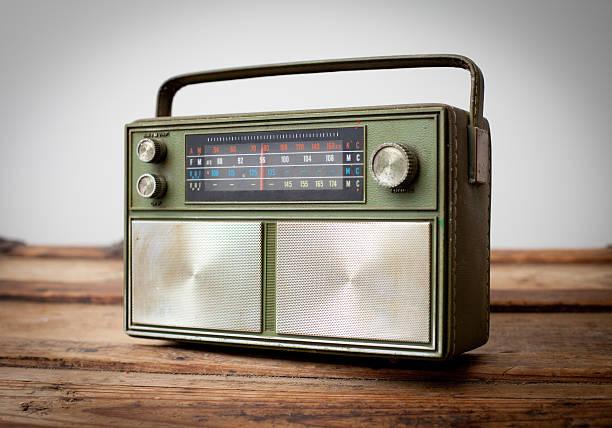 Vintage Green Portable Radio Sitting on Wood Table stock photo