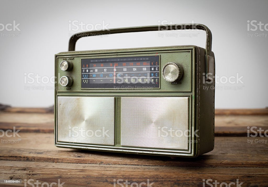 Vintage Green Portable Radio Sitting on Wood Table stock photo