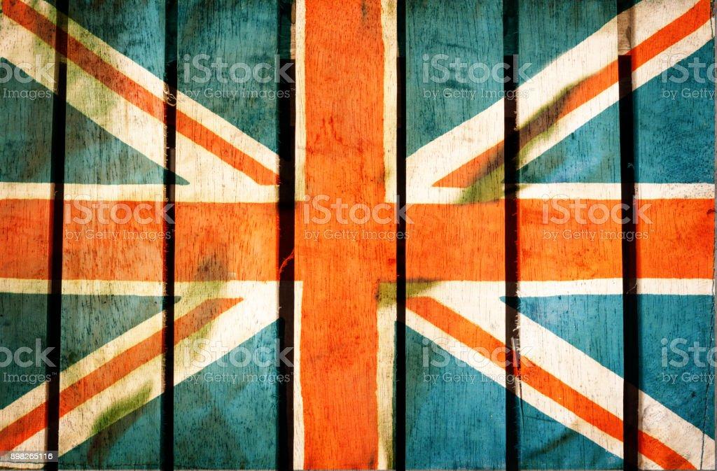 Vintage grunge filtered,United Kingdom flag on wood background stock photo