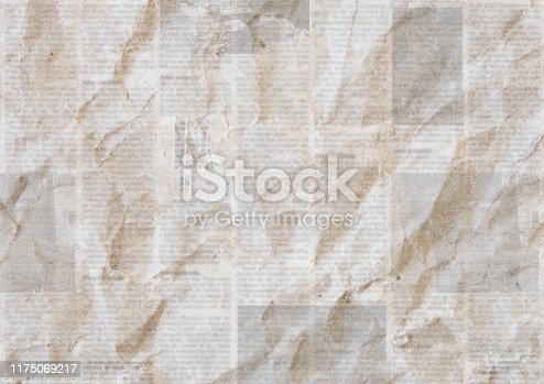 istock Vintage grunge newspaper paper texture background. Blurred old newspaper background. 1175069217