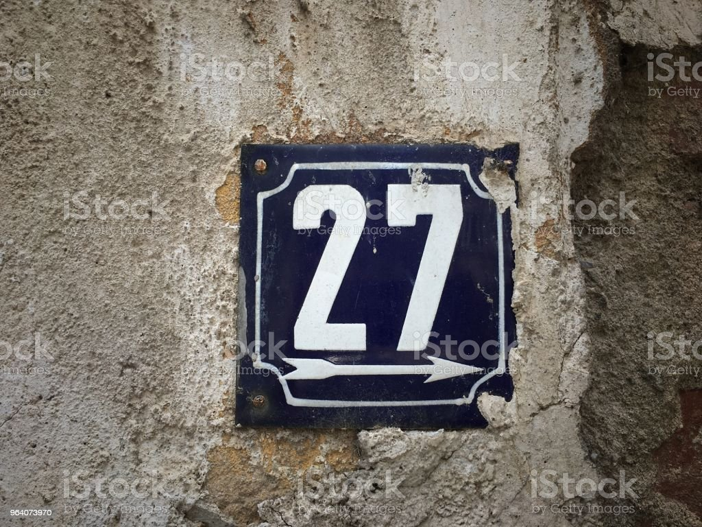 Vintage grunge square metal rusty plate of number of street address with number closeup - Royalty-free Architecture Stock Photo