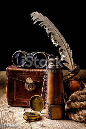 istock Vintage grunge still life. Antique items on wooden table 1019384650