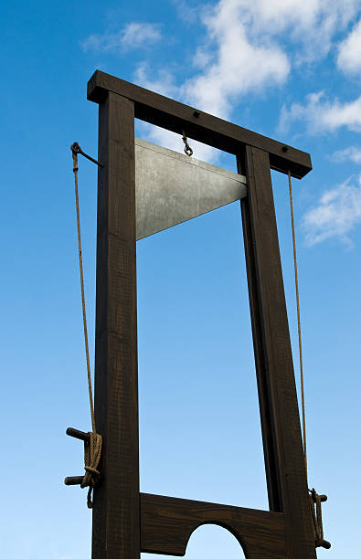 A vintage guillotine used for beheading stock photo