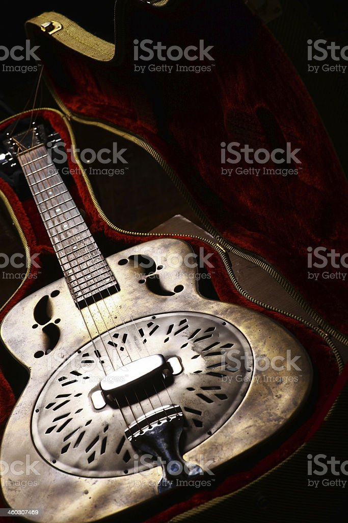 Vintage guitar in case stock photo