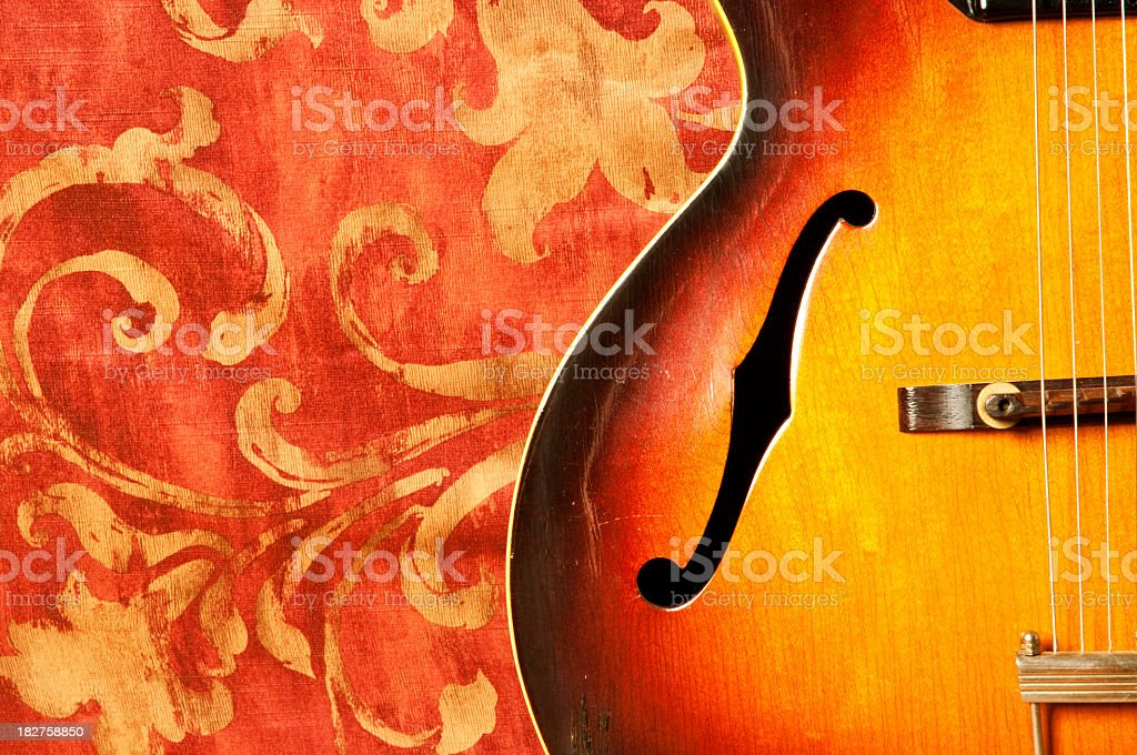 Vintage guitar with a red background royalty-free stock photo