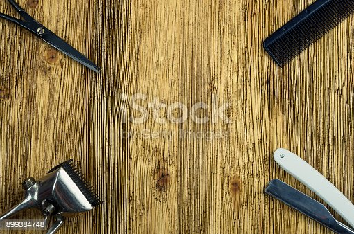 868725110istockphoto Vintage hairdressing tools on a rough wooden center surface 899384748