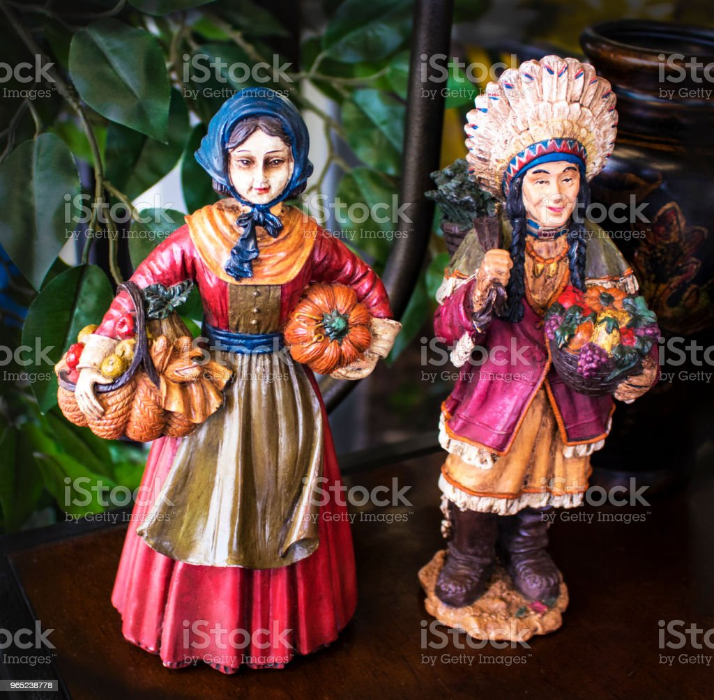 Vintage hand painted Pilgrim and Indian figurines for Thanksgiving zbiór zdjęć royalty-free