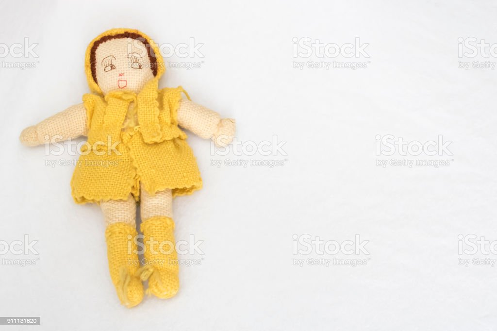 Vintage Handmade Knit Doll on White Background stock photo