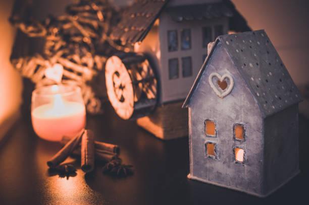 Vintage Handmade Lantern cardboard christmas house candle holder.  Beautiful and creative home decoration. stock photo