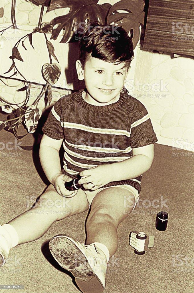 Vintage happy boy in sepia colors stock photo