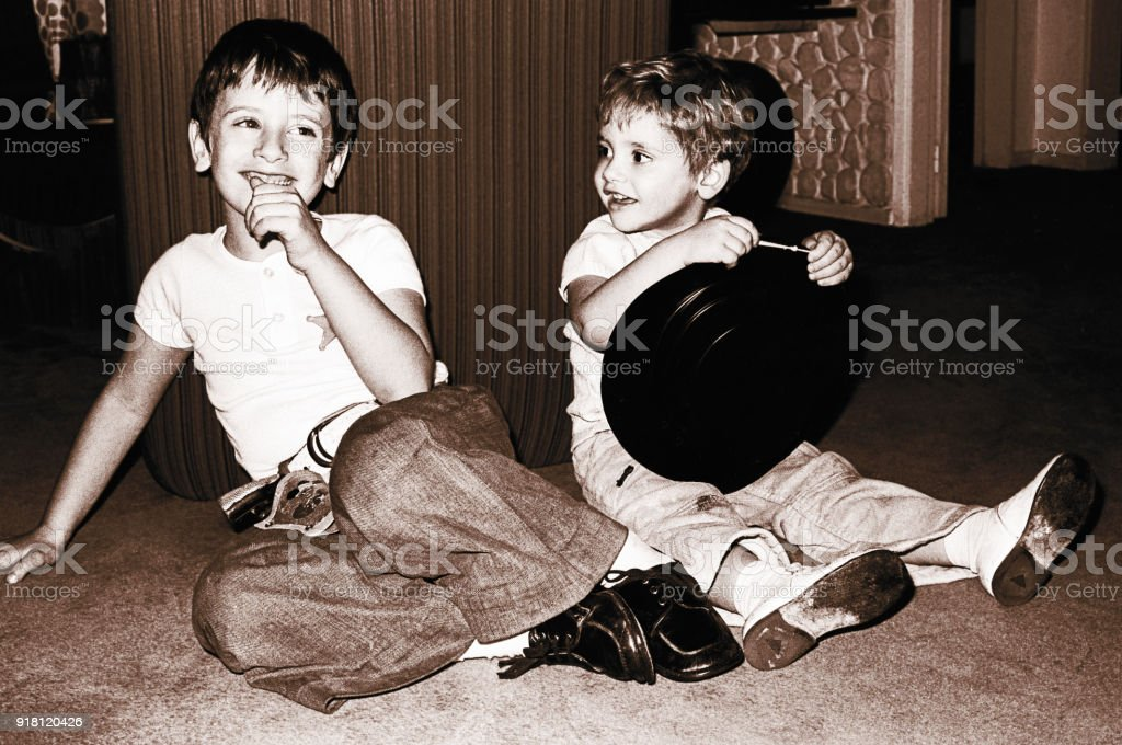 Vintage happy kids having fun stock photo