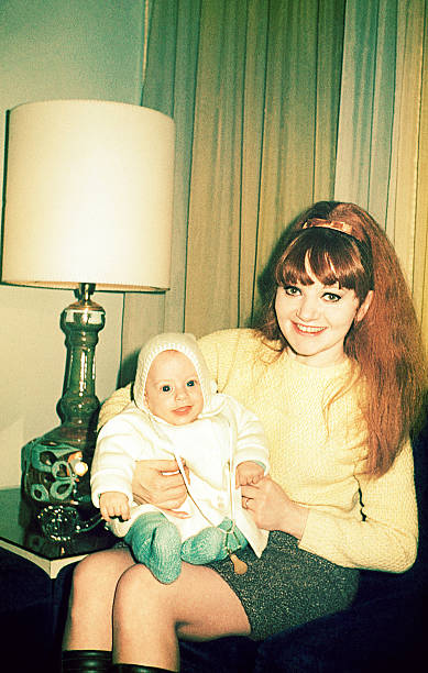 vintage happy mom holding her son - 1960s style stock photos and pictures