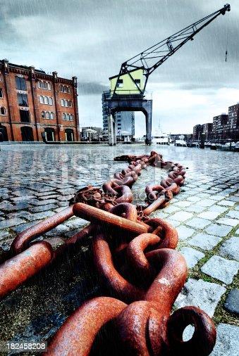 vintage harbor crane in the rain