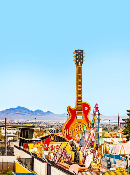 Vintage Hard Rock Cafe giant guitar sign seen at dusk in the Neon Museum open-air exhibit stock photo