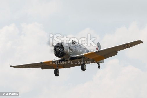 Cambridge, UK - May 27, 2012: A vintage North American Harvard trainer in RAF colours seen at Duxford Air Show.